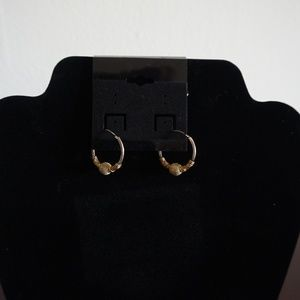 small hoop earrings with gold center detail